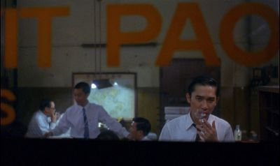 Still from In the Mood For Love (2000) that has been tagged with: smoking